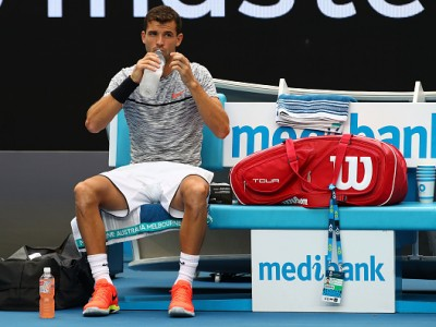 MELBOURNE, AUSTRALIA - JANUARY 17:  Grigor Dimitrov of Bulgaria takes a drink in his first round match against Christopher O'Connell of Australia on day two of the 2017 Australian Open at Melbourne Park on January 17, 2017 in Melbourne, Australia.  (Photo by Clive Brunskill/Getty Images)