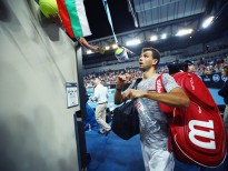 MELBOURNE, AUSTRALIA - JANUARY 17:  Grigor Dimitrov of Bulgaria signs autographs for the crowd after victory in his first round match against Christopher O'Connell of Australia on day two of the 2017 Australian Open at Melbourne Park on January 17, 2017 in Melbourne, Australia.  (Photo by Clive Brunskill/Getty Images)