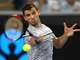 MELBOURNE, AUSTRALIA - JANUARY 17:  Grigor Dimitrov of Bulgaria plays a forehand in his first round match against Christopher O'Connell of Australia on day two of the 2017 Australian Open at Melbourne Park on January 17, 2017 in Melbourne, Australia.  (Photo by Clive Brunskill/Getty Images)