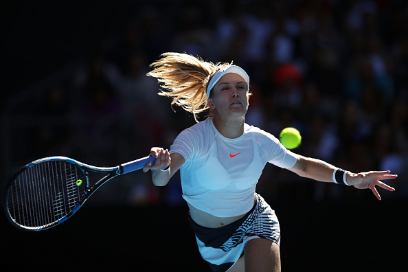 MELBOURNE, AUSTRALIA - JANUARY 18:  Eugenie Bouchard of Canada plays a forehand in her second round match against Shuai Peng of China on day three of the 2017 Australian Open at Melbourne Park on January 18, 2017 in Melbourne, Australia.  (Photo by Clive Brunskill/Getty Images)