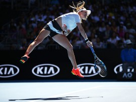 MELBOURNE, AUSTRALIA - JANUARY 18:  Eugenie Bouchard of Canada serves in her second round match against Shuai Peng of China on day three of the 2017 Australian Open at Melbourne Park on January 18, 2017 in Melbourne, Australia.  (Photo by Clive Brunskill/Getty Images)