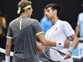 World No. 2 Novak Djokovic (R) and 117th-ranked Denis Istomin meet at the net after the Uzbek's upset second-round victory at the Australian Open in Melbourne on Jan. 19, 2017. Istomin won 7-6(8), 5-7, 2-6, 7-6(5), 6-4. (Kyodo) ==Kyodo