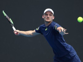 MELBOURNE, AUSTRALIA - JANUARY 17:  David Goffin of Belarus plays a forehand in his first round match against Reilly Opelka of the United States on day two of the 2017 Australian Open at Melbourne Park on January 17, 2017 in Melbourne, Australia.  (Photo by Scott Barbour/Getty Images)