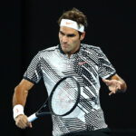 MELBOURNE, AUSTRALIA - JANUARY 20:  Roger Federer of Switzerland plays a backhand in his third round match against Thomas Berdych of the Czech Republic on day five of the 2017 Australian Open at Melbourne Park on January 20, 2017 in Melbourne, Australia.  (Photo by Cameron Spencer/Getty Images)
