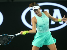 MELBOURNE, AUSTRALIA - JANUARY 20: Garbine Muguruza of Spain plays a forehand in her third round match against Anastasija Sevastova of Latvia on day five of the 2017 Australian Open at Melbourne Park on January 20, 2017 in Melbourne, Australia. (Photo by Pat Scala/Getty Images)