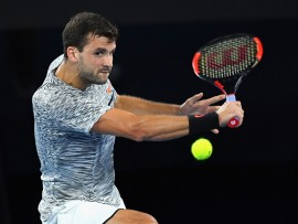 MELBOURNE, AUSTRALIA - JANUARY 21:  Grigor Dimitrov of Bulgaria plays a backhand in his third round match against Richard Gasquet of France on day six of the 2017 Australian Open at Melbourne Park on January 21, 2017 in Melbourne, Australia.  (Photo by Quinn Rooney/Getty Images)