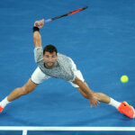 MELBOURNE, AUSTRALIA - JANUARY 21:  Grigor Dimitrov  of Bulgaria  plays a forehand  in his third round match against Richard Gasquet of France on day six of the 2017 Australian Open at Melbourne Park on January 21, 2017 in Melbourne, Australia.  (Photo by Pat Scala/Getty Images)