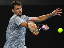 MELBOURNE, AUSTRALIA - JANUARY 23:  Grigor Dimitrov of Bulgaria plays a forehand in his fourth round match against Denis Istomin of Uzbekistan on day eight of the 2017 Australian Open at Melbourne Park on January 23, 2017 in Melbourne, Australia.  (Photo by Quinn Rooney/Getty Images)