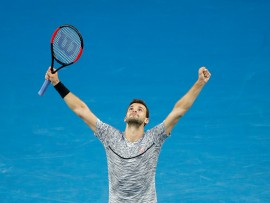 MELBOURNE, AUSTRALIA - JANUARY 23:  Grigor Dimitrov of Bulgaria celebrates winning his fourth round match against Denis Istomin of Uzbekistan  on day eight of the 2017 Australian Open at Melbourne Park on January 23, 2017 in Melbourne, Australia.  (Photo by Darrian Traynor/Getty Images)