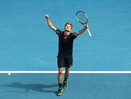 MELBOURNE, AUSTRALIA - JANUARY 23:  David Goffin of Belgium celebrates winning his fourth round match against Dominic Thiem of Austria on day eight of the 2017 Australian Open at Melbourne Park on January 23, 2017 in Melbourne, Australia.  (Photo by Scott Barbour/Getty Images)