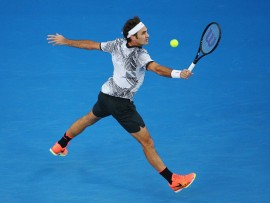 MELBOURNE, AUSTRALIA - JANUARY 24:  Roger Federer of Switzerland plays a backhand in his quarterfinal match against Mischa Zverev of Germany day nine of the 2017 Australian Open at Melbourne Park on January 24, 2017 in Melbourne, Australia.  (Photo by Michael Dodge/Getty Images)
