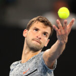 MELBOURNE, AUSTRALIA - JANUARY 27:  Grigor Dimitrov of Bulgaria serves in his semifinal match against Rafael Nadal of Spain on day 12 of the 2017 Australian Open at Melbourne Park on January 27, 2017 in Melbourne, Australia.  (Photo by Scott Barbour/Getty Images)
