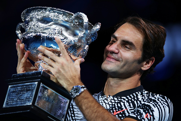 MELBOURNE, AUSTRALIA - JANUARY 29:  Roger Federer of Switzerland kisses the Norman Brookes Challenge Cup after winning the Men's Final match against Rafael Nadal of Spain on day 14 of the 2017 Australian Open at Melbourne Park on January 29, 2017 in Melbourne, Australia.  (Photo by Clive Brunskill/Getty Images)