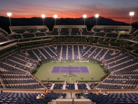 The sun sets behind center court as Romina Oprandi,  of Italy, and Svetlana Kuznetsova, of Russia, play at the Pacific Life Open tennis tournament, Saturday, March 10, 2007, in Indian Wells, Calif. (AP Photo/Mark J. Terrill)