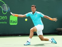 KEY BISCAYNE, FL - MARCH 25:  Tomas Berdych of the Czech Republic returns a shot against Andrey Rublev of Russia  during day 6 of the Miami Open at Crandon Park Tennis Center on March 25, 2017 in Key Biscayne, Florida.  (Photo by Al Bello/Getty Images)