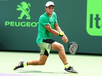 KEY BISCAYNE, DE - MARCH 23:  Borna Coric of Croatia returns a shot against Marcel Granollers of Spain  during Day 4 of the Miami Open at Crandon Park Tennis Center on March 23, 2017 in Key Biscayne, Florida.  (Photo by Al Bello/Getty Images)