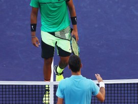 INDIAN WELLS, CA - MARCH 15:  Nick Kyrgios of Australia walks to the net after his straight set victory against Novak Djokovic of Serbia in their fourth round match during day ten of the BNP Paribas Open at Indian Wells Tennis Garden on March 15, 2017 in Indian Wells, California.  (Photo by Clive Brunskill/Getty Images)