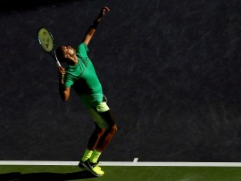 INDIAN WELLS, CA - MARCH 15:  Nick Kyrgios of Australia serves to Novak Djokovic of Serbia during the BNP Paribas Open at the Indian Wells Tennis Garden on March 15, 2017 in Indian Wells, California.  (Photo by Matthew Stockman/Getty Images)
