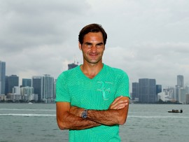 KEY BISCAYNE, FL - APRIL 02:  Roger Federer of Switzerland poses in front of the Miami Skyline after defeating  Rafael Nadal of Spain during the Men's Final and day 14 of the Miami Open at Crandon Park Tennis Center on April 2, 2017 in Key Biscayne, Florida.  (Photo by Al Bello/Getty Images)