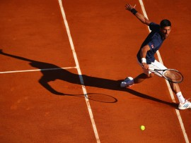 MONTE-CARLO, MONACO - APRIL 20:  Novak Djokovic of Serbia plays a backhand volley against Pablo Carreno Busta of Spain in his third round match on day five of the Monte Carlo Rolex Masters at Monte-Carlo Sporting Club on April 20, 2017 in Monte-Carlo, Monaco.  (Photo by Clive Brunskill/Getty Images)