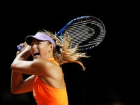 STUTTGART, GERMANY - APRIL 26:  Maria Sharapova of Russia hits a backhand during her match against Roberta Vinci of Italy during the Porsche Tennis Grand Prix at Porsche Arena on April 26, 2017 in Stuttgart, Germany.  (Photo by Adam Pretty/Bongarts/Getty Images)