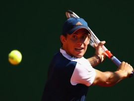 MONTE-CARLO, MONACO - APRIL 19:  Dominic Thiem of Austria plays a backhand against Robin Haase of the Netherlands in his second round match on day four of the Monte Carlo Rolex Masters at Monte-Carlo Sporting Club on April 19, 2017 in Monte-Carlo, Monaco.  (Photo by Clive Brunskill/Getty Images)
