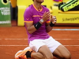 MADRID, SPAIN - MAY 14:  Rafael Nadal of Spain celebrates after winning at match point against Dominic Thiem of Austria in the final during day nine of the Mutua Madrid Open tennis at La Caja Magica on May 14, 2017 in Madrid, Spain.  (Photo by Julian Finney/Getty Images)
