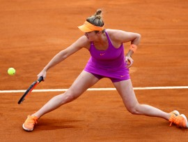 Elina Svitolina of Ukraine hits a return to Karolina Pliskova (CZE) during their match at the WTA Tennis Open quarterfinals at the Foro Italico in Rome, on May 19, 2017.  (Photo by Matteo Ciambelli/NurPhoto via Getty Images)