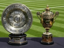 LONDON, ENGLAND - JUNE 25:  The Gentlemen's and Ladies' trophies are seen on centre court during previews for Wimbledon Tennis 2016 at Wimbledon on June 25, 2016 in London, England.  (Photo by Julian Finney/Getty Images)