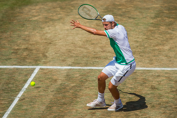 STUTTGART, GERMANY - JUNE 18: Lucas Pouille of France returns the ball during the final match between Feliciano Lopez of Spain and Lucas Pouille of France at the MercedesCup 2017 on June 18, 2017 in Stuttgart, Germany. (Photo by Thomas Niedermueller/Bongarts/Getty Images)