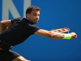 LONDON, ENGLAND - JUNE 19:  Grigor Dimitrov of Bulgaria plays a backhand during the mens singles first round match against Ryan Harrison of The United States during day one of the 2017 Aegon Championships at Queens Club on June 19, 2017 in London, England.  (Photo by Clive Brunskill/Getty Images)
