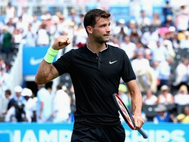 LONDON, ENGLAND - JUNE 19:  Grigor Dimitrov of Bulgaria celebrates victory during the mens singles first round match against Ryan Harrison of The United States during day one of the 2017 Aegon Championships at Queens Club on June 19, 2017 in London, England.  (Photo by Clive Brunskill/Getty Images)
