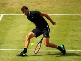 LONDON, ENGLAND - JUNE 21:  Grigor Dimitrov of Bulgaria returns the ball through his legs during the mens singles second round match against Julien Benneteau of France on day three of the 2017 Aegon Championships at Queens Club on June 21, 2017 in London, England.  (Photo by Clive Brunskill/Getty Images)