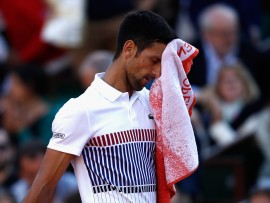 PARIS, FRANCE - JUNE 04:  Novak Djokovic of Serbia looks dejected during the mens singles fourth round match against Albert Ramos-Vinolas of Spain on day eight of the 2017 French Open at Roland Garros on June 4, 2017 in Paris, France.  (Photo by Adam Pretty/Getty Images)