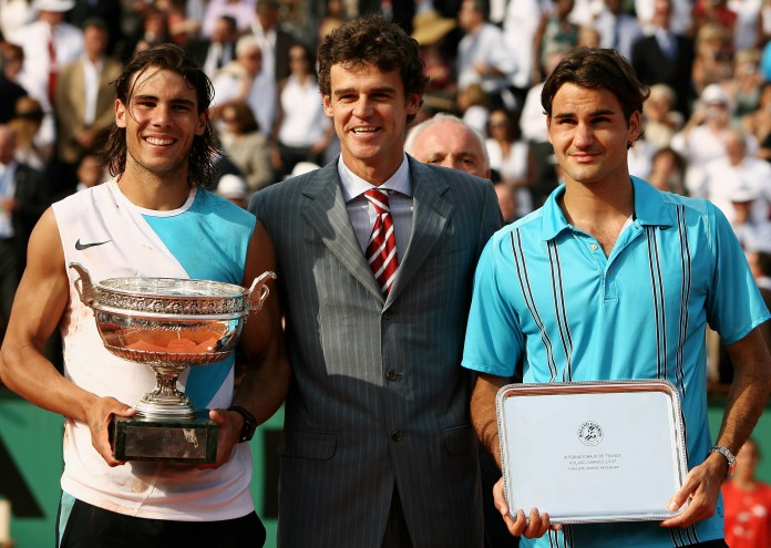 PARIS - JUNE 10: Rafael Nadal (L) of Spain poses with the Philippe Chatrier Trophy after winning against Roger Federer (R) of Switzerland and former winner Gustavo Kuerten (C) after the Men's Singles Final on day fifteen of the French Open at Roland Garros on June 10, 2007 in Paris, France. (Photo by Clive Brunskill/Getty Images)