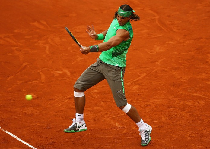 PARIS - JUNE 03: Rafael Nadal of Spain hits a forehand during the Men's Singles Quarter Final match against Nicolas Almagro of Spain on day ten of the French Open at Roland Garros on June 3, 2008 in Paris, France. (Photo by Julian Finney/Getty Images)