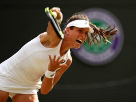 LONDON, ENGLAND - JULY 07:  Johanna Konta of Great Britain serves during the Ladies Singles third round match against Maria Sakkari of Greece on day five of the Wimbledon Lawn Tennis Championships at the All England Lawn Tennis and Croquet Club on July 7, 2017 in London, England.  (Photo by Julian Finney/Getty Images)
