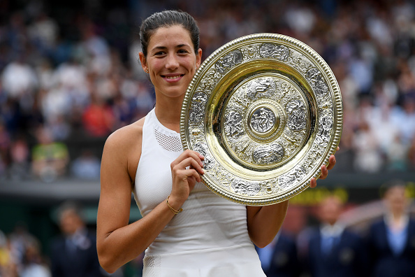 LONDON, ENGLAND - JULY 15: Garbine Muguruza of Spain celebrates victory with the trophy after the Ladies Singles final against Venus Williams of The United States on day twelve of the Wimbledon Lawn Tennis Championships at the All England Lawn Tennis and Croquet Club at Wimbledon on July 15, 2017 in London, England. (Photo by Shaun Botterill/Getty Images)