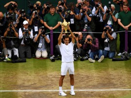 LONDON, ENGLAND - JULY 16:  Roger Federer of Switzerland celebrates victory with the trophy as he poses for photographers after the Gentlemen's Singles final against  Marin Cilic of Croatia on day thirteen of the Wimbledon Lawn Tennis Championships at the All England Lawn Tennis and Croquet Club at Wimbledon on July 16, 2017 in London, England.  (Photo by Shaun Botterill/Getty Images)