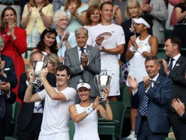 Martina Hingis and Jamie Murray celebrate victory in the mixed doubles final against Heather Watson and Henri Kontinen (back) on day thirteen of the Wimbledon Championships at The All England Lawn Tennis and Croquet Club, Wimbledon. (Photo by John Walton/PA Images via Getty Images)