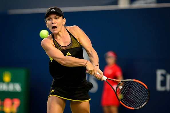 TORONTO, ON - AUGUST 09: Simona Halep of Romania (ROU) returns the ball during her second round match of the 2017 Rogers Cup tennis tournament on August 9, 2017, at Aviva Centre in Toronto, ON, Canada. (Photograph by Julian Avram/Icon Sportswire via Getty Images)