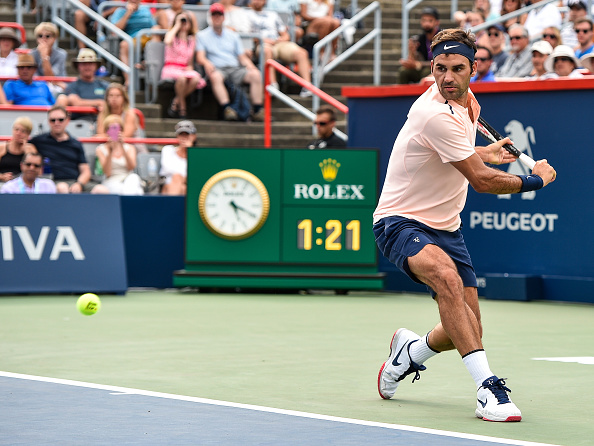 MONTREAL, QC - AUGUST 10:  Roger Federer of Switzerland prepares to hit a return against David Ferrer of Spain during day seven of the Rogers Cup presented by National Bank at Uniprix Stadium on August 10, 2017 in Montreal, Quebec, Canada.  (Photo by Minas Panagiotakis/Getty Images)