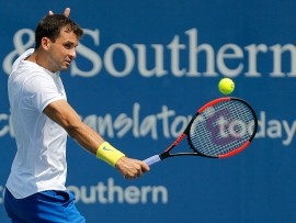 MASON, OH - AUGUST 16:  Grigor Dimitrov of Bulgaria returns a shot to Feliciano Lopez of Spain during Day 5 of the Western and Southern Open at the Lindner Family Tennis Center on August 16, 2017 in Mason, Ohio.  (Photo by Michael Reaves/Getty Images)
