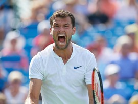 CINCINNATI, OH - AUGUST 19: Grigor Dimitrov of Bulgaria looks to his team box and lets out a yell after winning his semi-final match against John Isner of the United States in the Western & Southern Open at the Lindner Family Tennis Center in Cincinnati, OH. Dimitrov went on to win the match 7-6, 7-6.  (Photo by Shelley Lipton/Icon Sportswire via Getty Images)