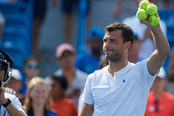 CINCINNATI, OH - AUGUST 19: Grigor Dimitrov of Bulgaria smiles after winning his semi-final match against John Isner of the United States in the Western & Southern Open at the Lindner Family Tennis Center in Cincinnati, OH. Dimitrov went on to win the match 7-6, 7-6.  (Photo by Shelley Lipton/Icon Sportswire via Getty Images)