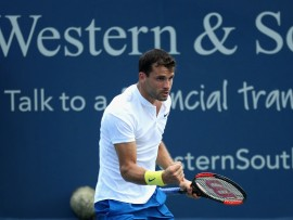 MASON, OH - AUGUST 17:  Grigor Dimitrov of Bulgaria celebrates after winning a point against Juan Martin Del Potro of Argentina during Day 6 of the Western and Southern Open at the Linder Family Tennis Center on August 17, 2017 in Mason, Ohio.  (Photo by Rob Carr/Getty Images)