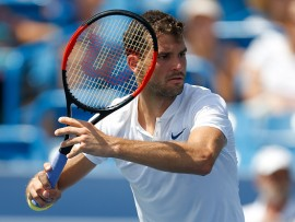 MASON, OH - AUGUST 17:  Grigor Dimitrov of Bulgaria returns a shot to Juan Martin Del Potro of Argentina during Day 6 of the Western and Southern Open at the Lindner Family Tennis Center on August 17, 2017 in Mason, Ohio.  (Photo by Michael Reaves/Getty Images)