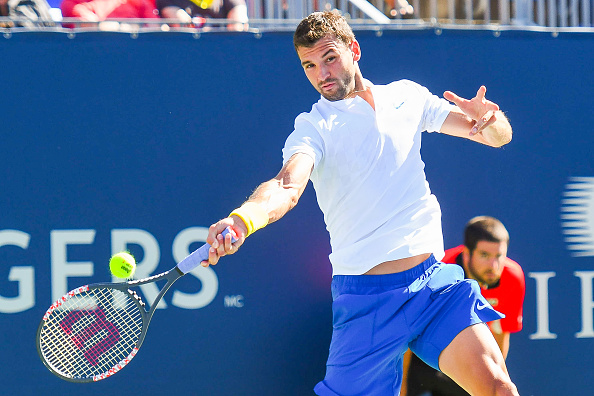 MONTREAL, QC - AUGUST 09: Grigor Dimitrov (BUL) returns the ball during his second round match at ATP Coupe Rogers on August 9, 2017, at Uniprix Stadium in Montreal, QC. (Photo by David Kirouac/Icon Sportswire via Getty Images)