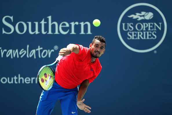 MASON, OH - AUGUST 18:  Nick Kyrgios of Australia serves to Ivo Karlovic of Croatia during Day 7 of the Western and Southern Open at the Linder Family Tennis Center on August 18, 2017 in Mason, Ohio.  (Photo by Rob Carr/Getty Images)