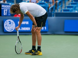 MASON, OH - AUGUST 16:  Alexander Zverev of Germany reacts against Frances Tiafoe of the United States during Day 5 of the Western and Southern Open at the Lindner Family Tennis Center on August 16, 2017 in Mason, Ohio.  (Photo by Michael Reaves/Getty Images)